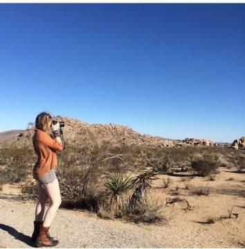 Aimee shooting photos in Joshu Tree